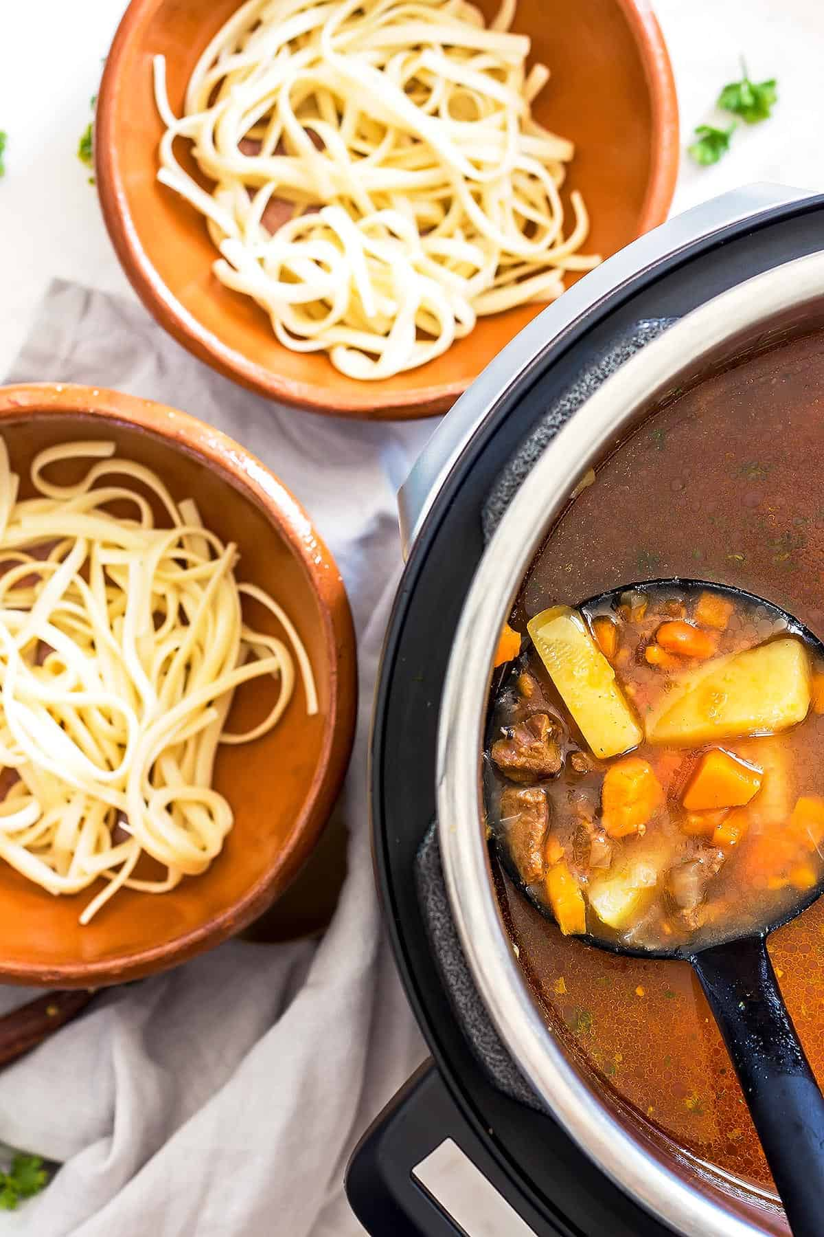 Noodles on bowls; vegetable beef soup in Instant Pot