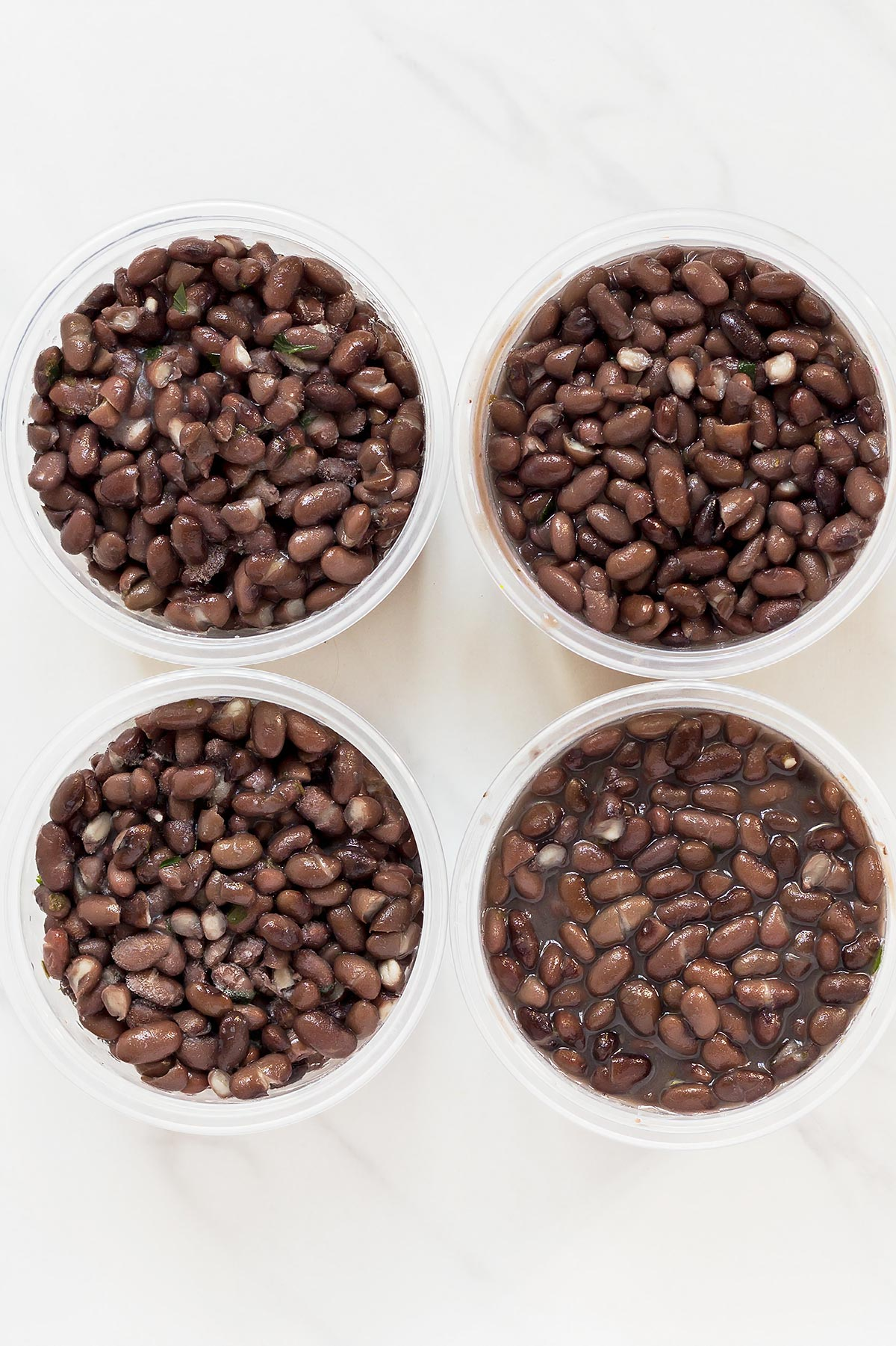 Cooked Instant Pot Black Beans in 4 storage containers