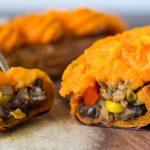 Cut open stuffed sweet potato half
