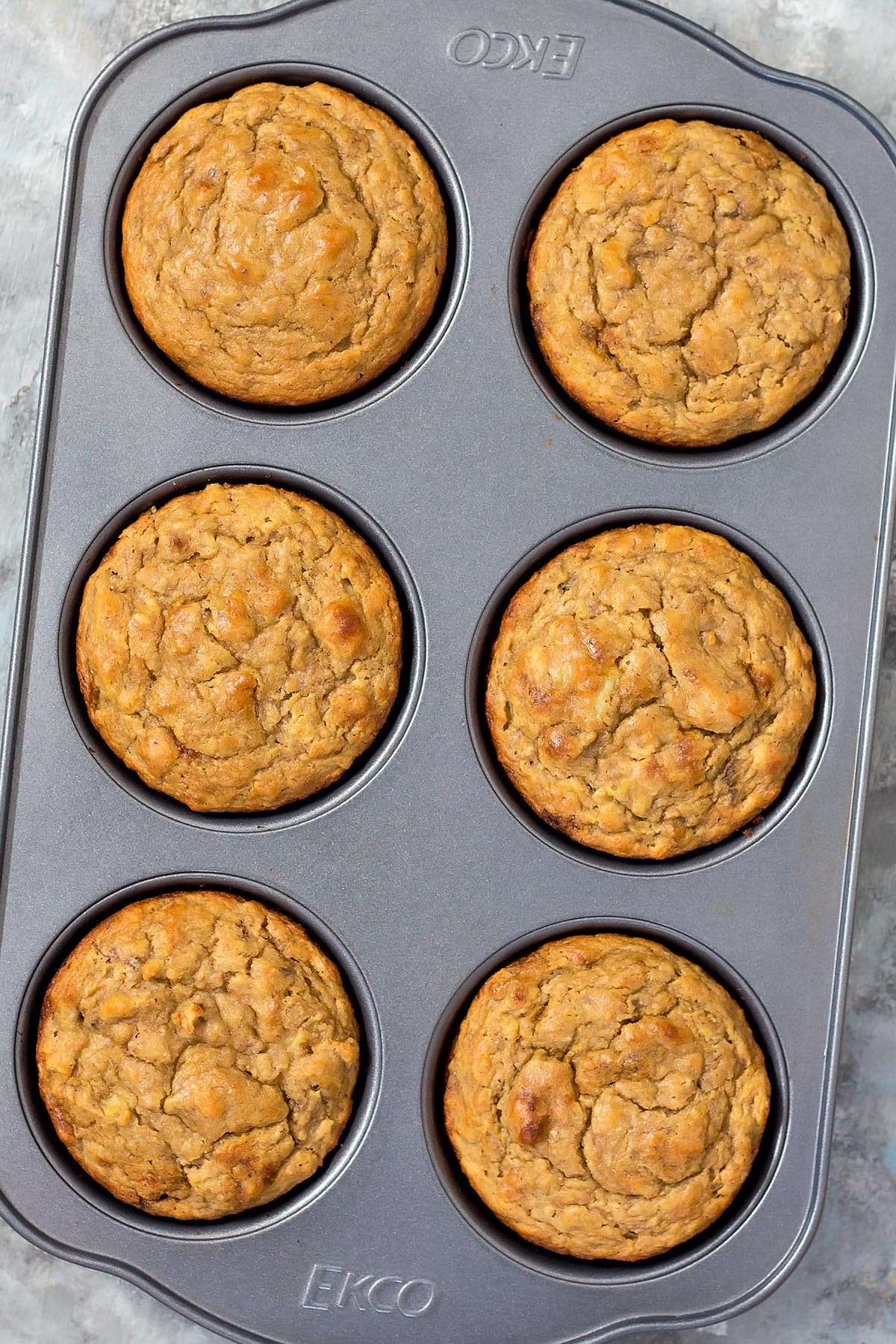 Baked Peanut Butter Banana Muffins in baking pan