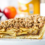 Closeup of slice of apple pie with crumb topping