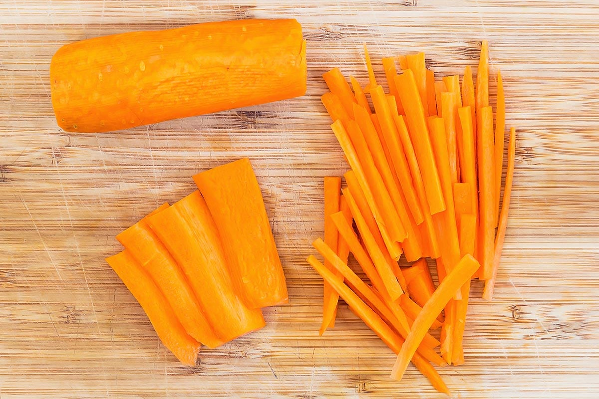 Matchstick carrots on cutting board