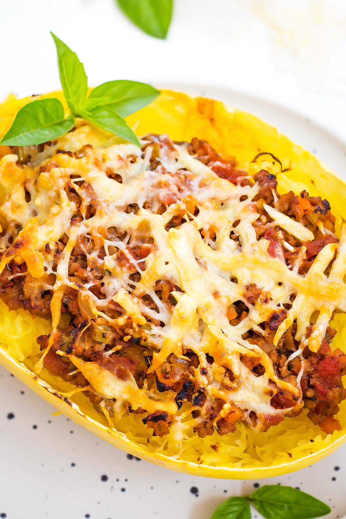 Spaghetti Squash Bolognese Boat with melted cheese