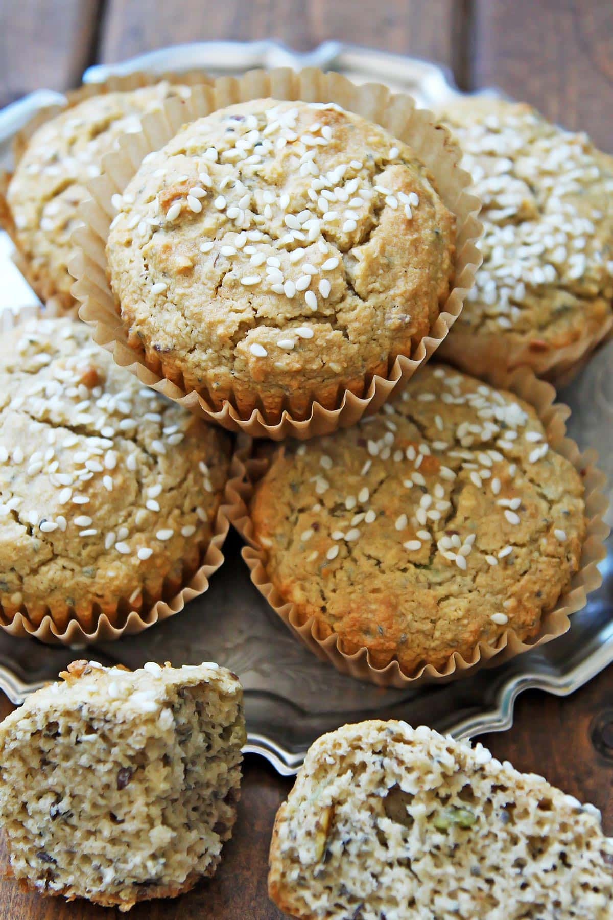 Tahini Sesame Seed Muffins on tray and wooden table