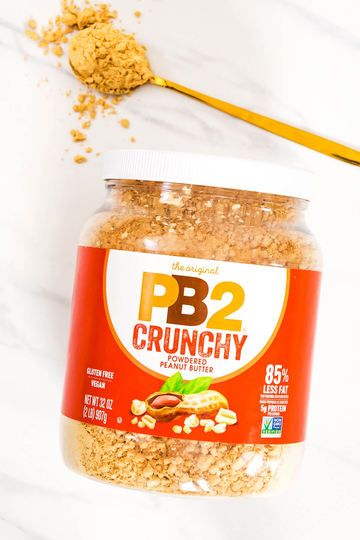 PB2 Crunchy Peanut Powder container with golden spoon of powder