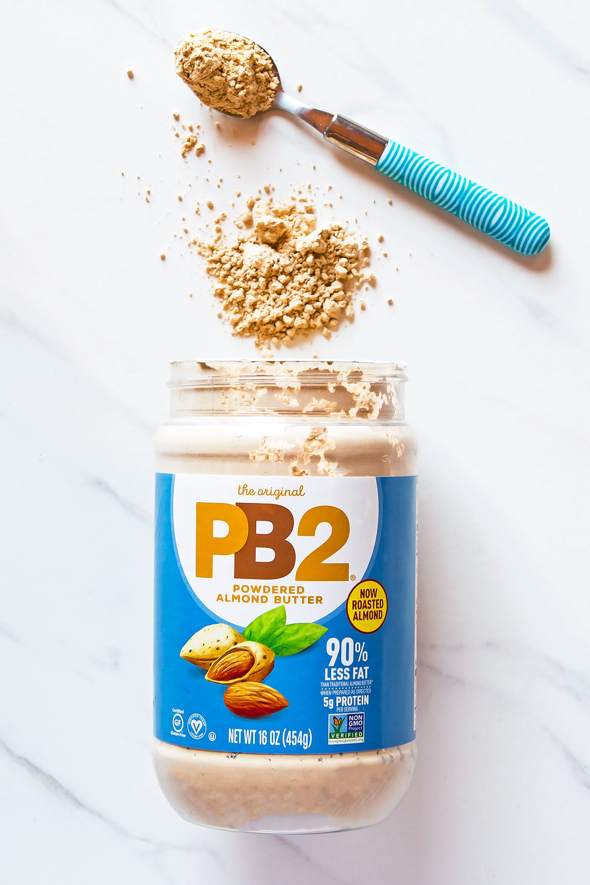 PB2 Powdered Almond Butter container with spoonful of powder on the side