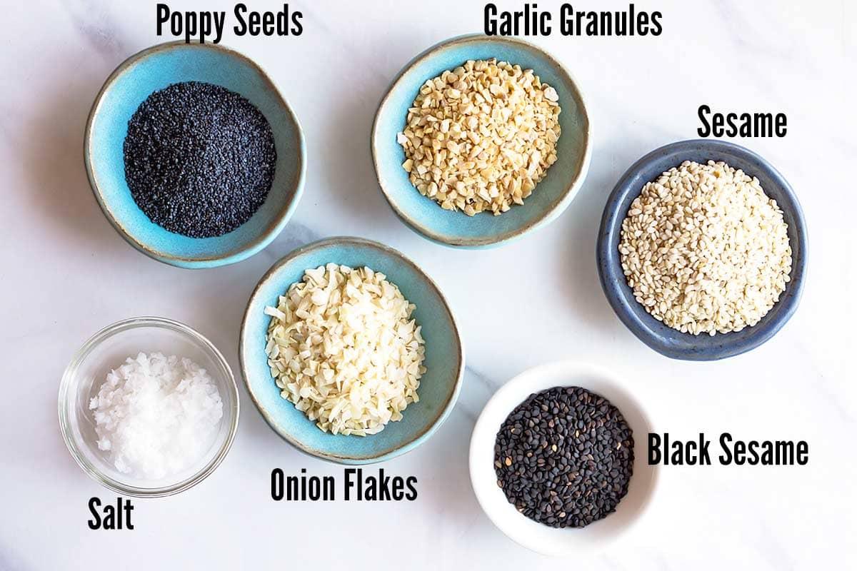 Ingredients for bagel seasoning in small individual bowls