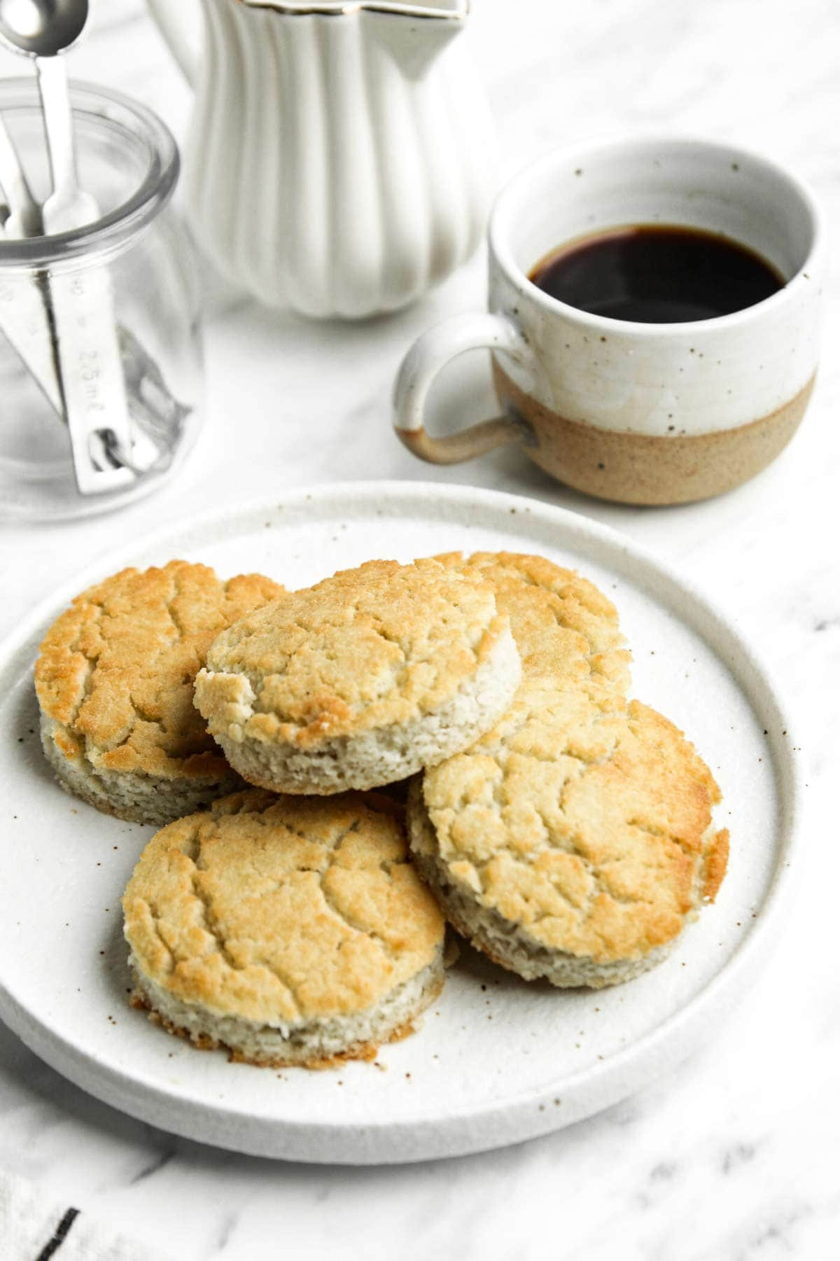 Low Carb Biscuits on plate with coffee mug in background