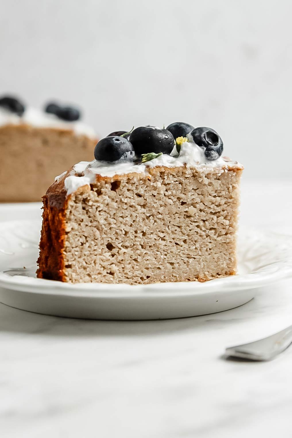 Slice of grain free banana cake on small plate