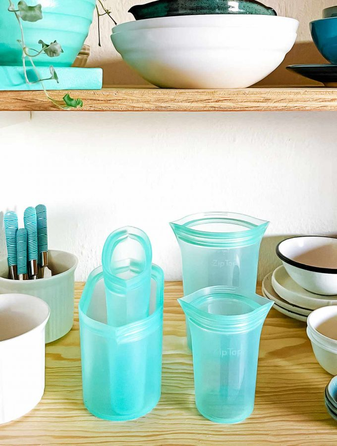 Teal Ziptop containers in shelf with other white and teal containers